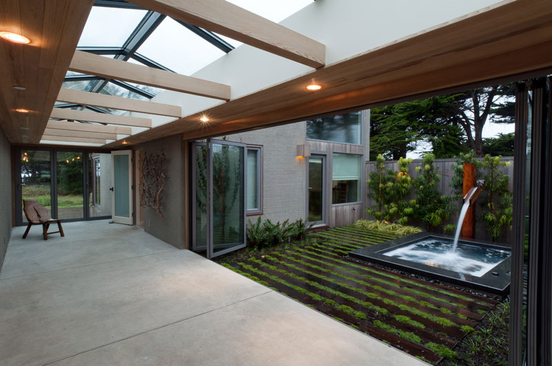 Sheltered Hallway With Long Skylight And Enclosed Garden Room Photo